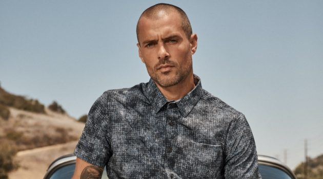 Sporting a printed short-sleeve shirt, Zac Taylor fronts 7Diamonds' summer 2021 campaign.