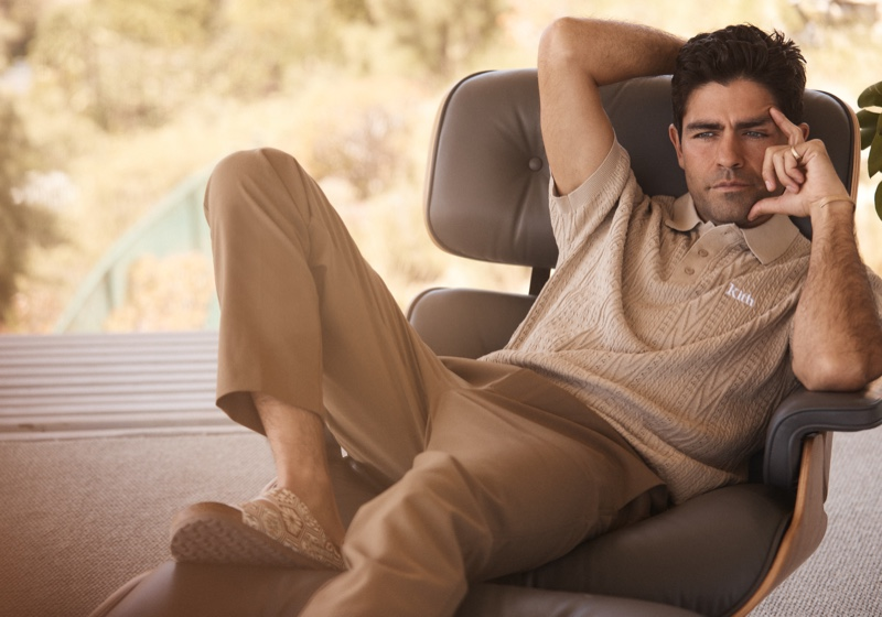 Actor Adrian Grenier relaxes in a knit polo for Kith's summer 2021 campaign.