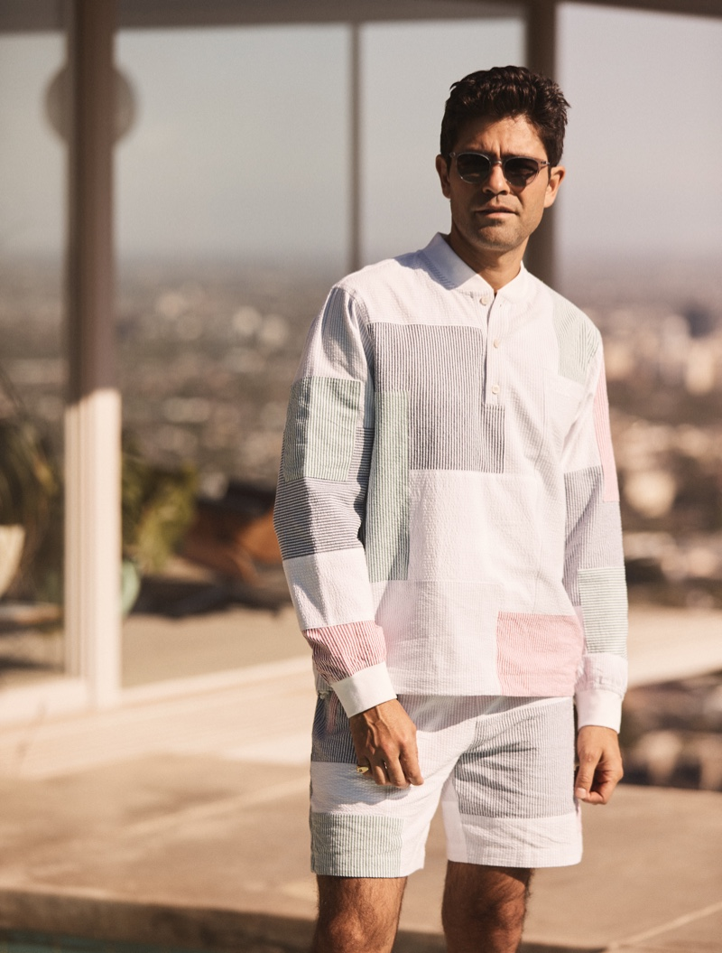 Fueling a certain nostalgia, Adrian Grenier is pictured in a patchwork-like shirt and shorts for Kith's summer 2021 campaign.