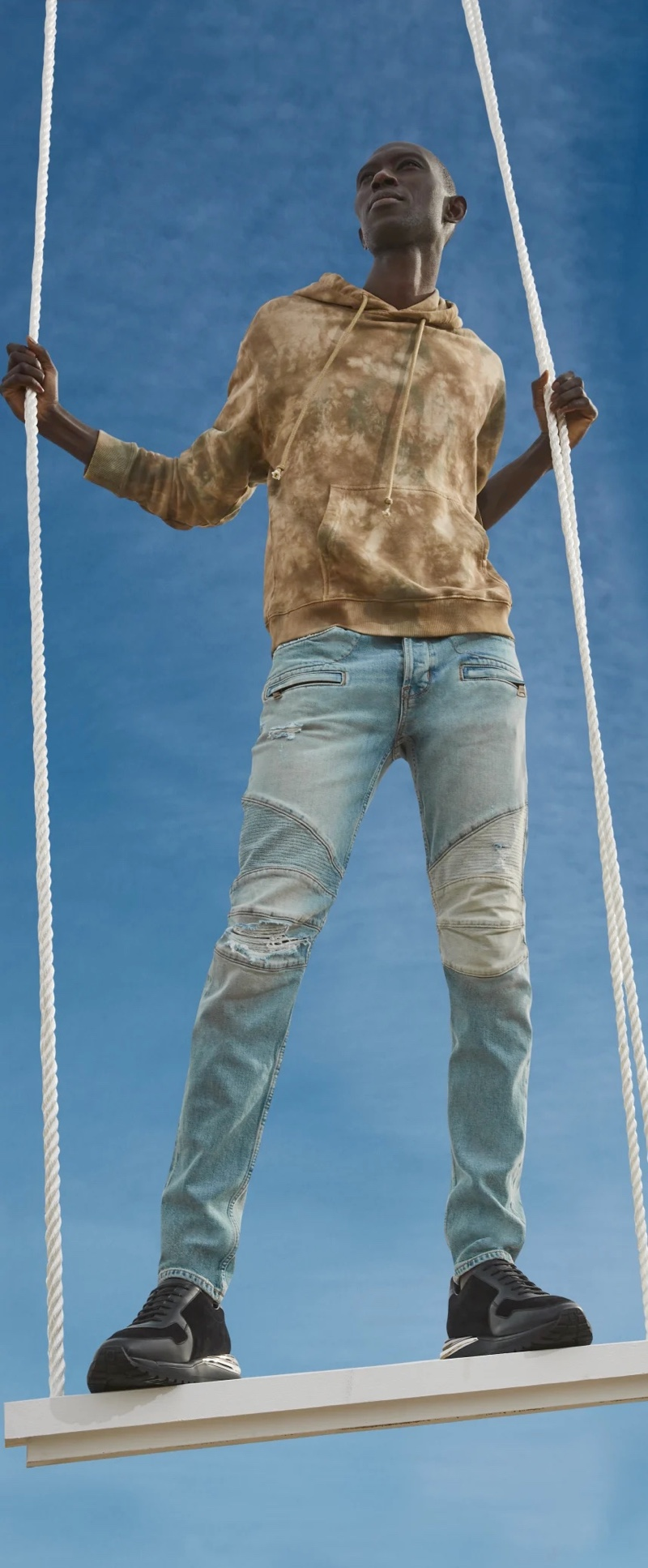 Going casual, Armando Cabral dons denim jeans with a tie-dye hoodie from Hudson Jeans.