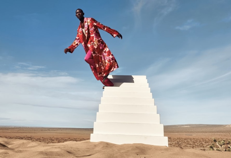 A sleek vision, Armando Cabral wears a floral print robe with pink satin pants from Tom Ford.