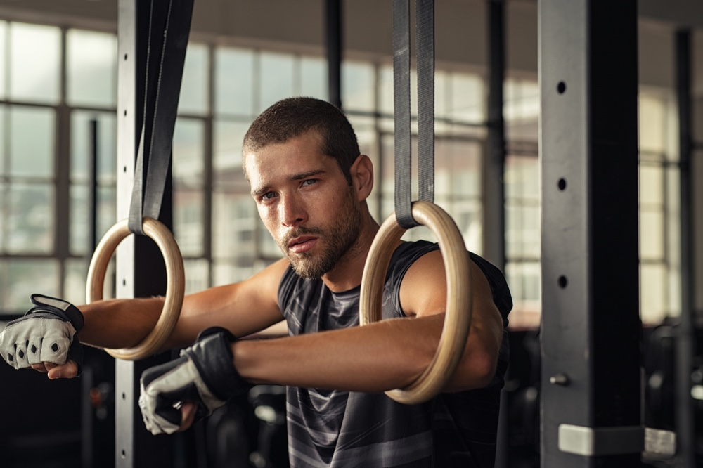 Athlete Gym Rings Tired Attractive Male