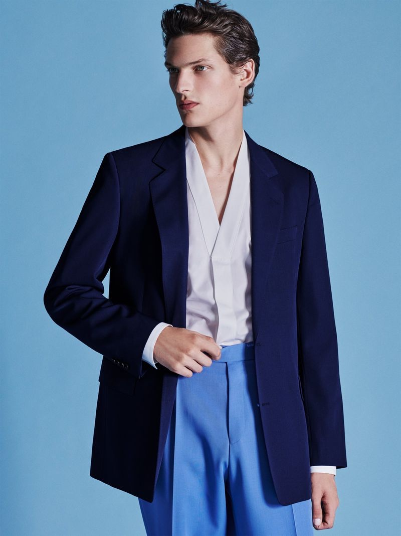 Tackling a chic tailored number, Valentin Caron wears a spring-summer 2021 look from BOSS.