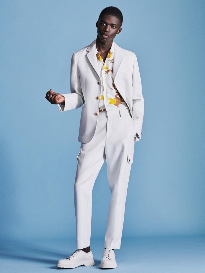 Remixing the suit, BOSS offers a fresh spin on cargo pants as worn by model Jeremiah Berko Fourdjour.