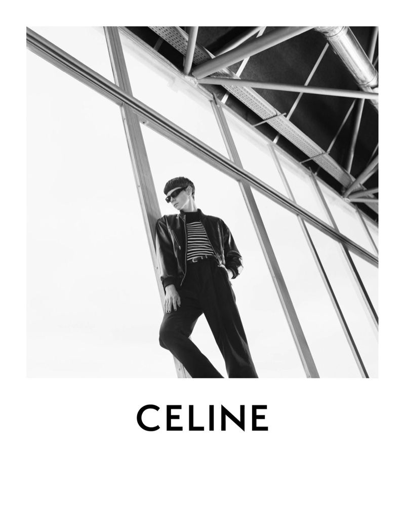 Donning a striped pullover and leather jacket, Isaac Lane fronts Celine's spring-summer 2021 men's campaign.
