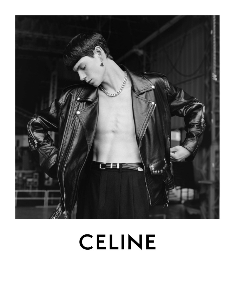 Rocking a leather biker jacket and pleated trousers, Isaac Lane appears in Celine's spring-summer 2021 men's campaign.