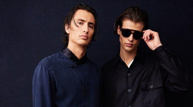 James Turlington and Bastien De Bels pose behind the scenes at Giorgio Armani's spring-summer 2022 show.