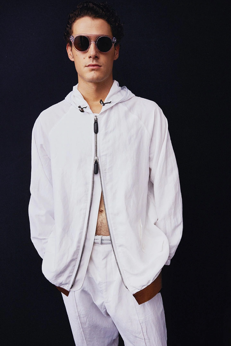 A vision in white, Tommaso Giannoni dons a look from Giorgio Armani's spring-summer 2022 collection.