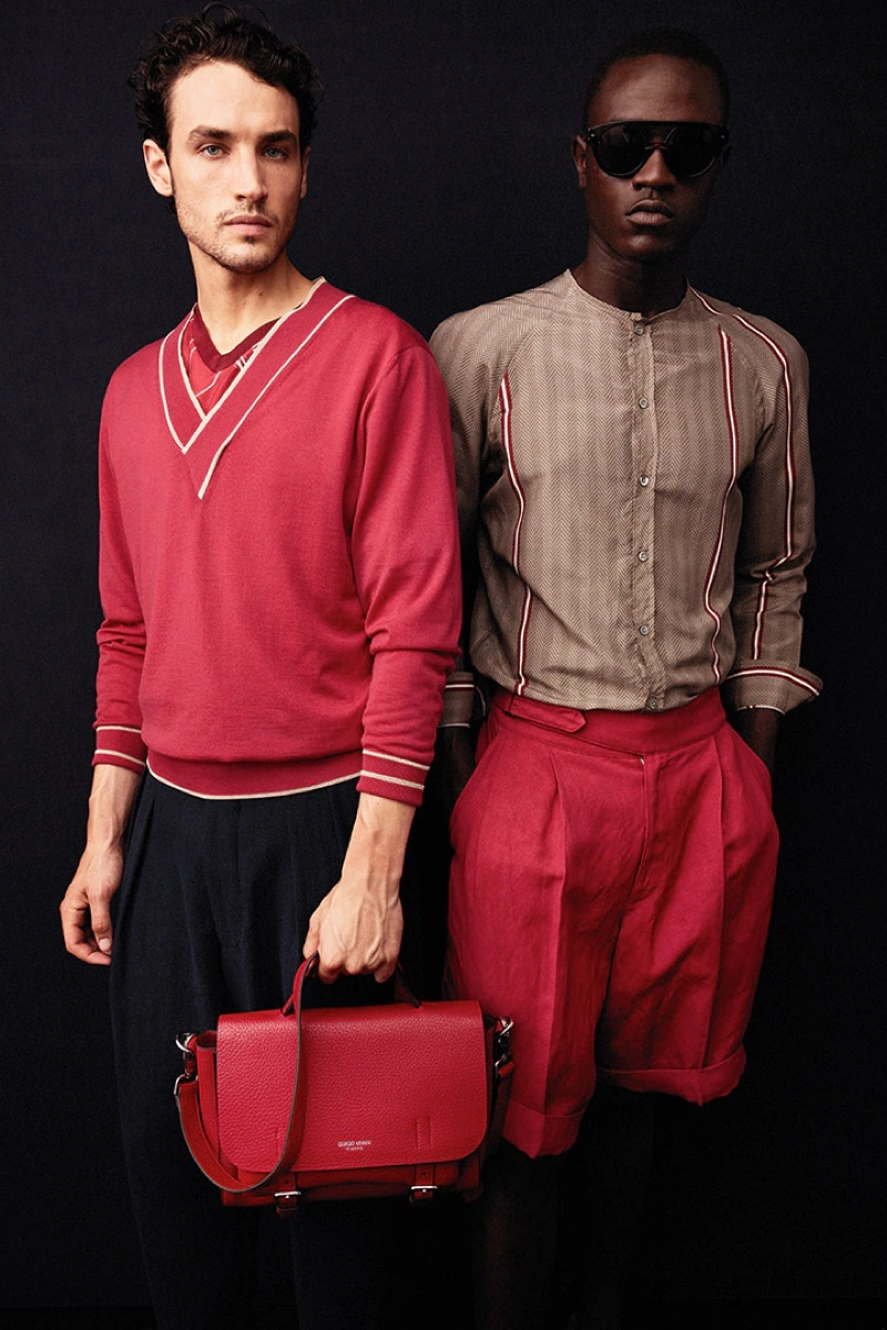 Federico Novello and Ismail Drammeh appear in a backstage image at Giorgio Armani's spring-summer 2022 show.