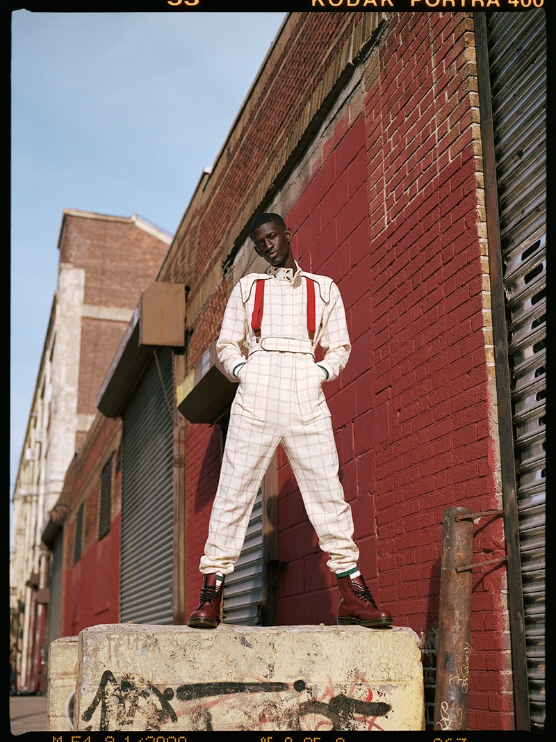 Ibby wears jumpsuit Casablanca, boots Dr Martens, and suspenders Club Room.