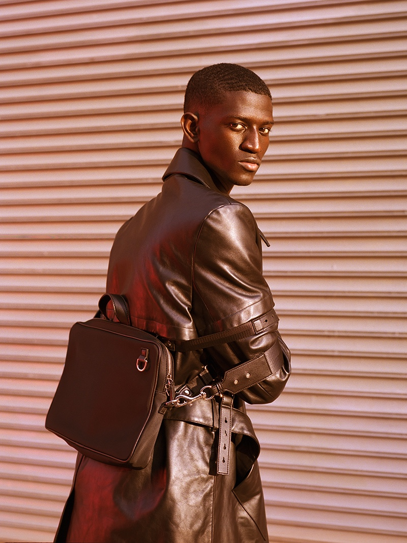Ibby wears coat Casablanca and bag Bond Hardware.