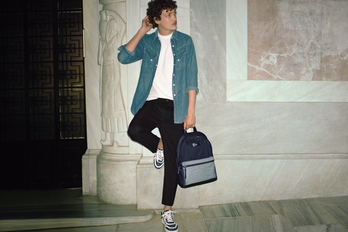 Model Swann Guerrault sports Jimmy Choo's Hawaii/M Navy JC Logo Jacquard and White Calf Leather Low Top Trainers.