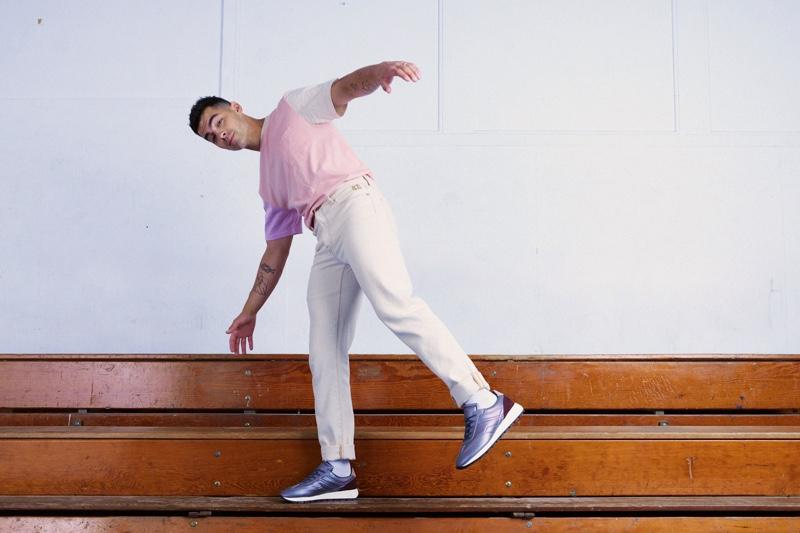 Pictured with his side to the camera, Joe Jonas sports KOIO's Retro Runner Joe Jonas sneakers.