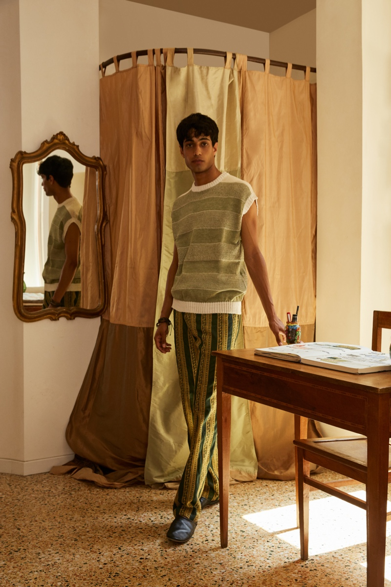 Matteo Tagliabue wears a striped sweater vest and patterned pants from Luca Larenza's spring-summer 2022 collection.