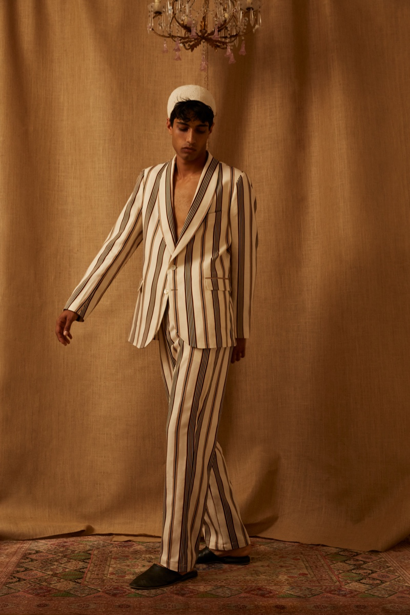 Making a smart statement in Luca Larenza, Matteo Tagliabue inspires in a striped suiting number.