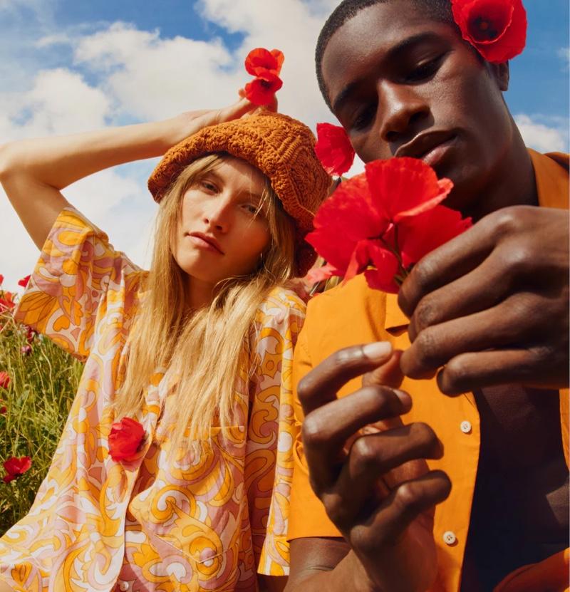 Channeling seventies style, Klara Kristin and Mukasa Kakonge model looks from Mango's summer 2021 collection.
