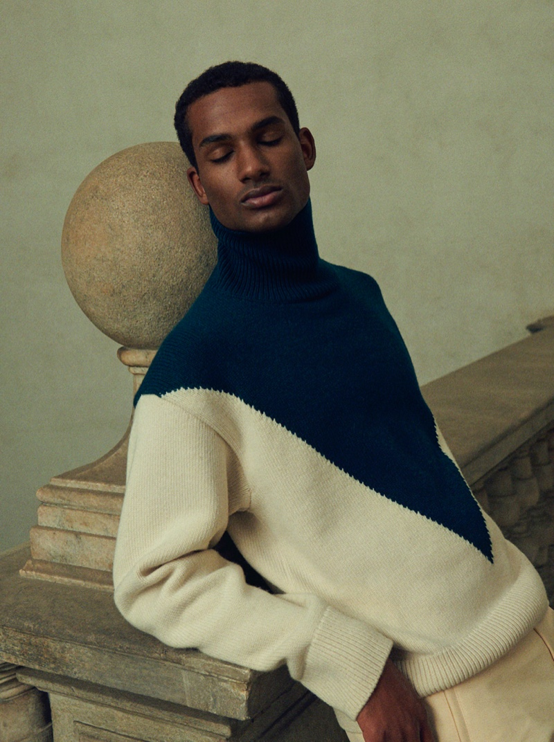Omar Didiba charms in an oversized sweater from Jil Sander for Mytheresa's pre-fall 2021 men's campaign.