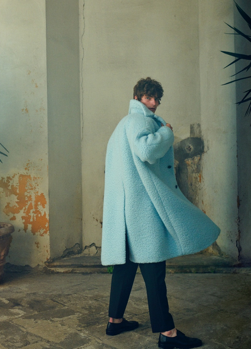 Stepping out for Mytheresa's pre-fall 2021 men's campaign, Erik Van Gils makes a statement in an oversized Prada coat with Jil Sander pants.