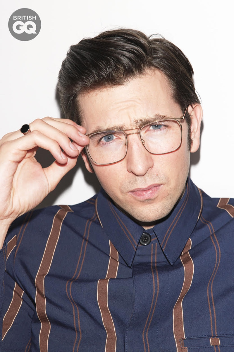 Sporting Moscot glasses for British GQ, Nicholas Braun also wears a Paul Smith shirt with a Miansai ring.