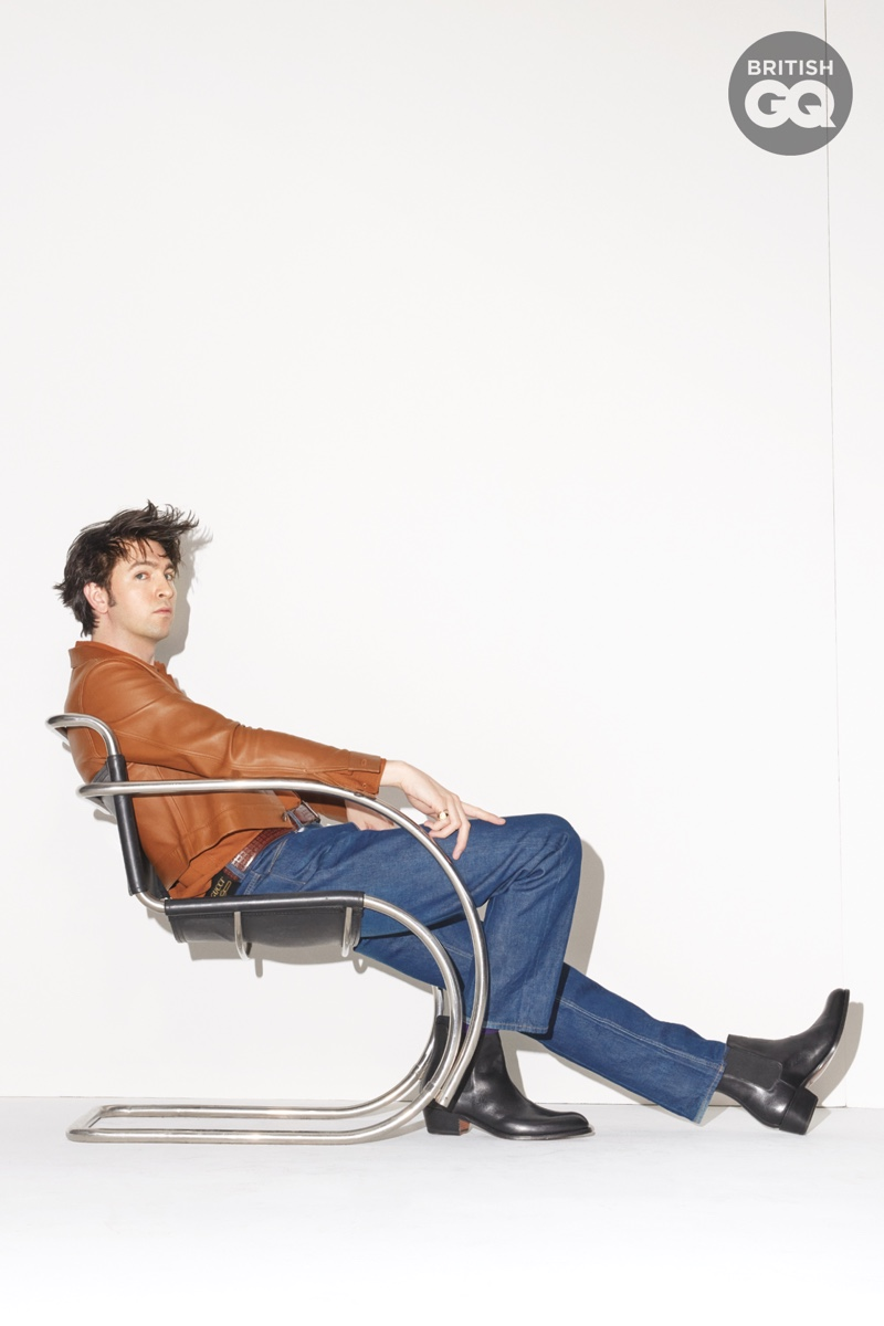 Jenny Livingston photographs Nicholas Braun from the side. Appearing in British GQ's latest cover story, Braun wears an AMI shirt and leather jacket with Gucci jeans. He also rocks Grenson boots with UNIQLO socks and Miansai rings.