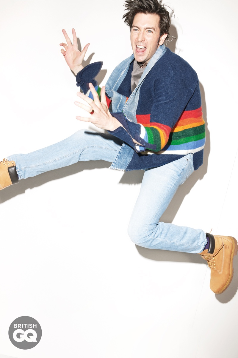 Spazzing out, Nicholas Braun dons a rainbow-striped cardigan by Greg Lauren. Gracing British GQ's pages, he also wears a Giorgio Armani sweatshirt, Brunello Cucinelli jeans, Timberland boots, and UNIQLO socks. Matthew Marden accessorizes Braun in a Caputo & Co. necklace with Miansai rings.