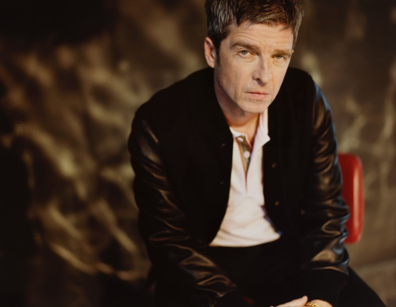 Sporting a Golden Bear wool-blend and leather bomber jacket with a Burberry logo-embroidered contrast-tipped cotton-piqué polo shirt, Noel Gallagher appears in Mr Porter's The Journal. He also dons Nudie Jeans slim-fit organic denim jeans.
