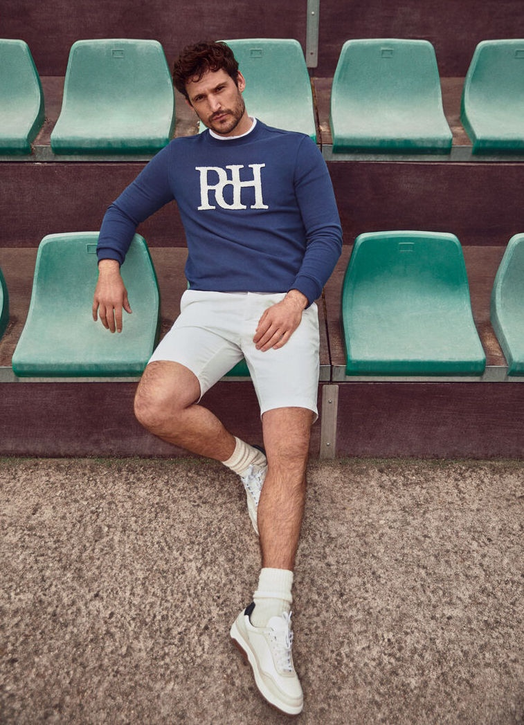 Sporting a Pedro del Hierro sweater with shorts, Sam Webb makes a smart style impression.