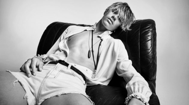 Romeo Beckham models short denim cut-off shorts for Saint Laurent's denim campaign.