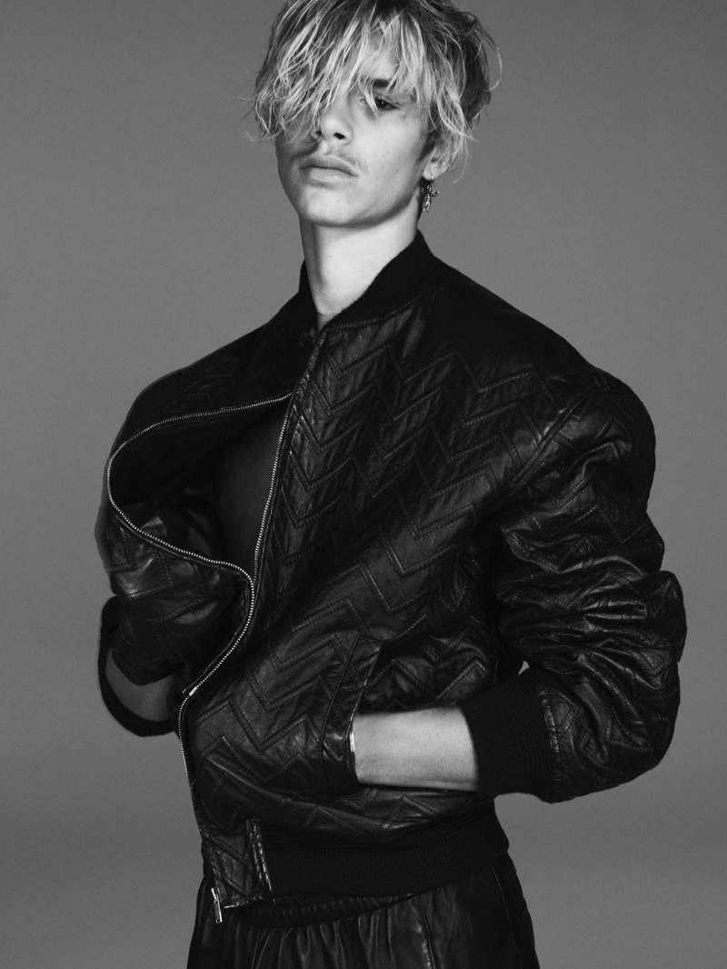 Styled in a leather bomber jacket, Romeo Beckham appears in Saint Laurent's fall-winter 2021 men's campaign.