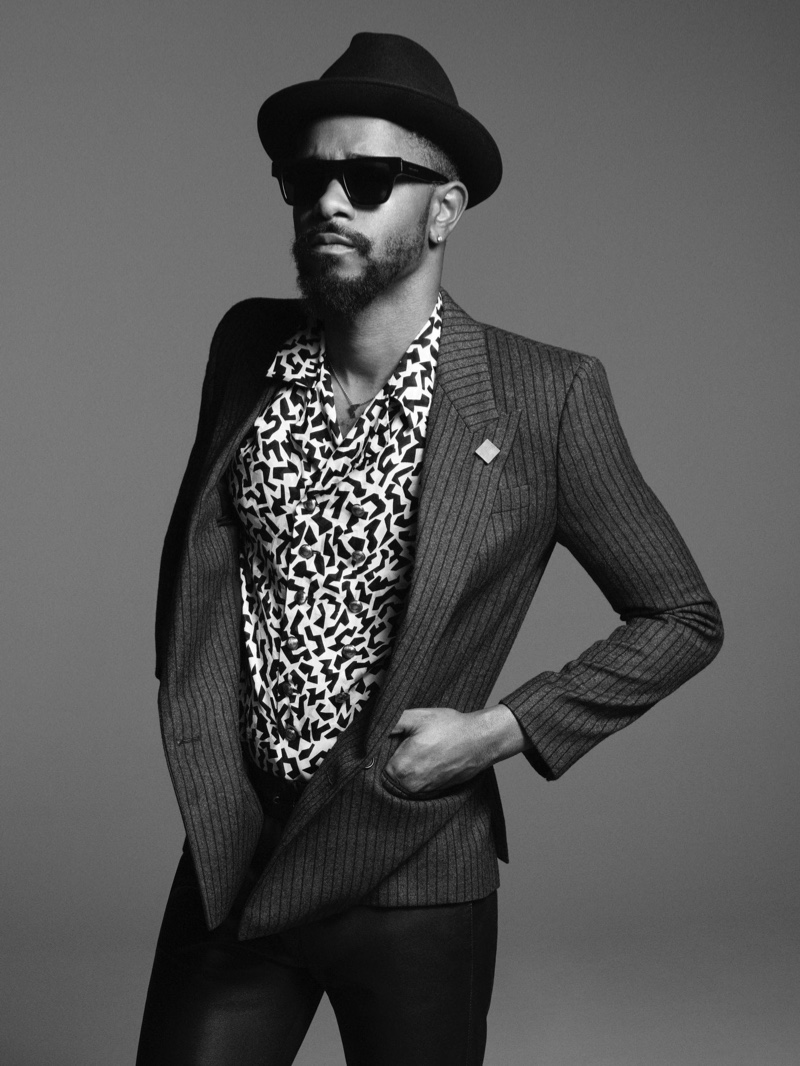 Actor Lakeith Stanfield dons slender tailoring, a fedora, and sunglasses for Saint Laurent's fall-winter 2021 men's campaign.