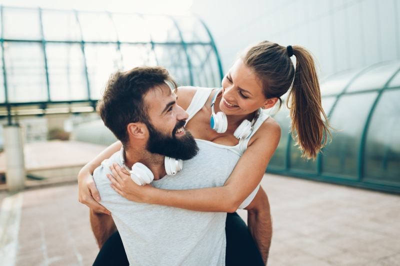 Smiling Couple Fitness Headphones