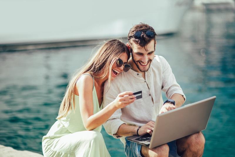 Smiling Couple Laptop Credit Card Shopping