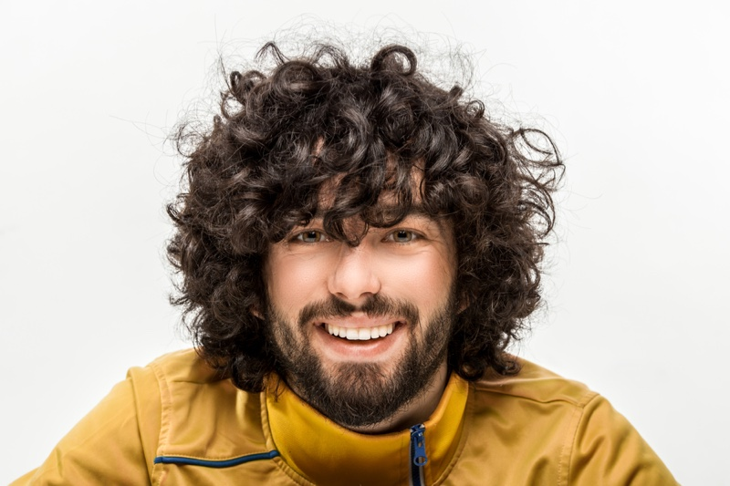 Smiling Man Curly Healthy Hair