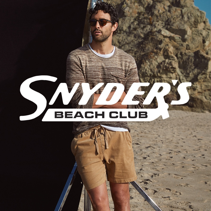 """Hitting the beach, Noah Mills wears Todd Snyder's cotton-linen ombre beach sweater in brown with 7"""" washed corduroy weekend shorts in khaki."""