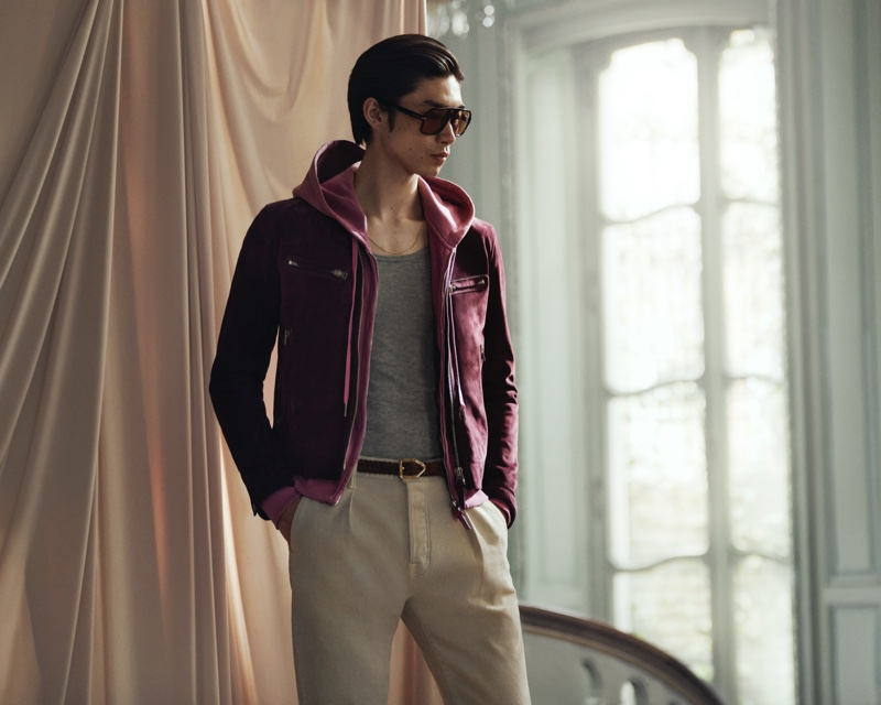 A sporty but luxurious vision, Hidetatsu Takeuchi sports Tom Ford's lilac zip-up hoodie, purple suede blouson jacket, brown aviator-style tortoiseshell acetate sunglasses, and slim-fit pleated stretch-denim jeans.