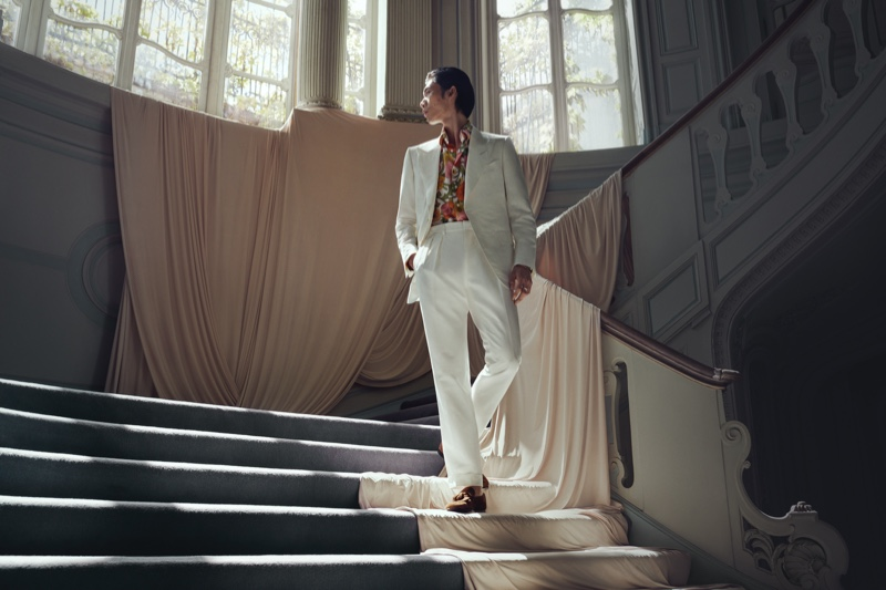 Embracing a dashing Tom Ford look, Hidetatsu Takeuchi  models a printed shirt and silk and linen-blend blazer with trousers.