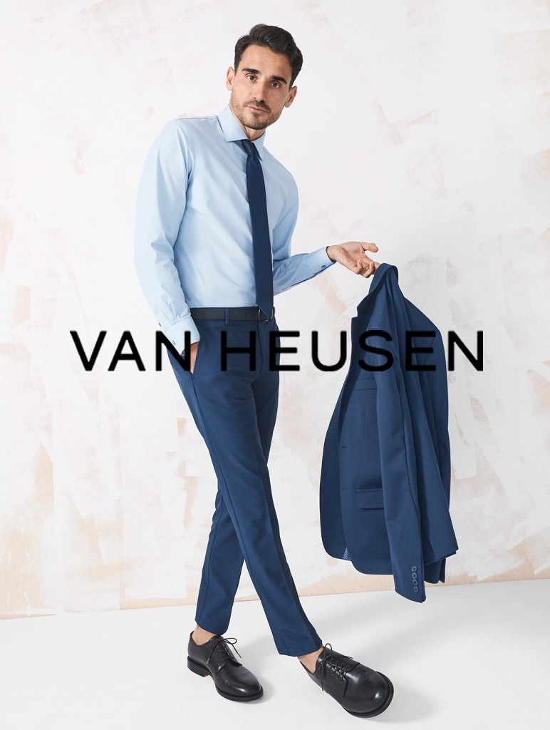 Donning a shirt, suit, and tie, Arthur Kulkov fronts Van Heusen's summer 2021 men's campaign.