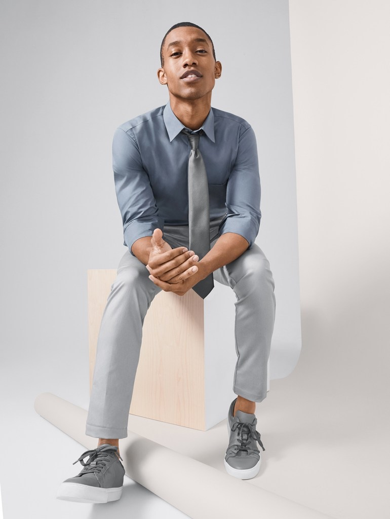 Front and center, Jerel Anderson wears shades of gray in a smart look from Van Heusen.