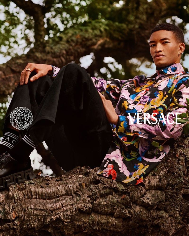 Donning a multicolored top and oversized pants, Raphael Balzer fronts Versace's pre-fall 2021 men's campaign.