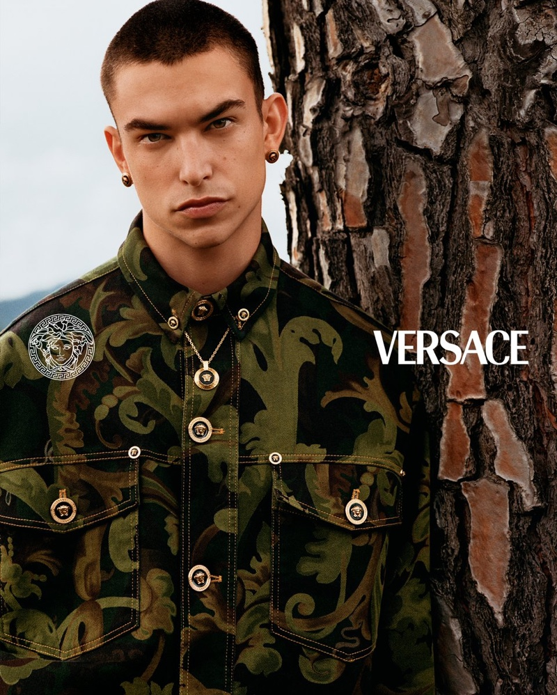Simone Bricchi models a printed jacket for Versace's pre-fall 2021 men's campaign.
