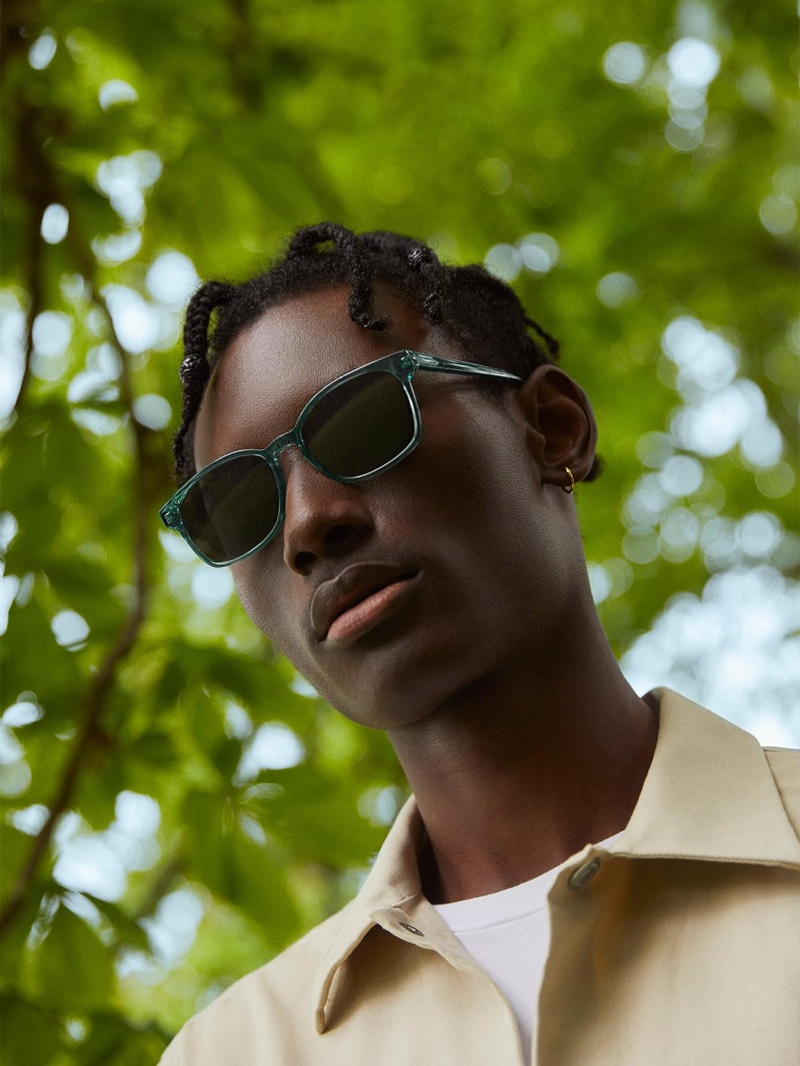 Warby Parker enlists model Youssouf Bamba to wear its colorful Hemmings sunglasses in Viridian.