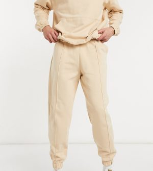 ASOS DESIGN Tall oversized sweatpants with pin tuck detail in beige-Neutral