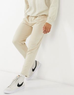 ASOS DESIGN organic tapered sweatpants with pleats in beige-Neutral