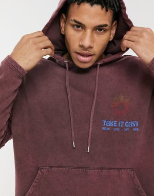 ASOS DESIGN oversized hoodie in brown acid wash with chest print