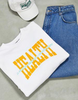 ASOS DESIGN oversized sweatshirt with health slogan chest print-White