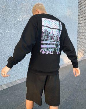 ASOS DESIGN oversized sweatshirt with photographic back print in black