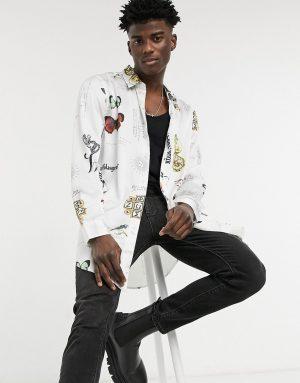 ASOS DESIGN regular longline satin shirt in white negative placement motifs print