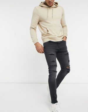 ASOS DESIGN skinny jeans in washed black with thigh rip