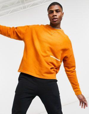 ASOS Unrvlld Spply oversized sweatshirt in wash with wraparound print-Brown