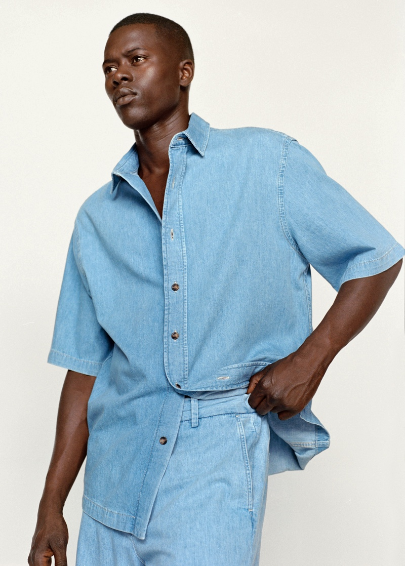 Doubling down on denim, Alpha Dia wears an oversized short-sleeve denim shirt with jeans from Mango.